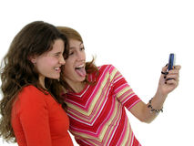 Two girls taking a photo of themselves royalty free stock images