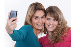 Two girls taking a picture Royalty Free Stock Images