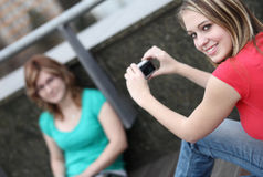 Two girls taking pictures Stock Images