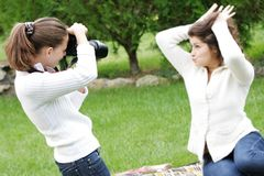 Two girls taking pictures Stock Photo