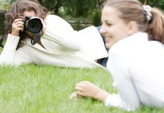 Two Girls Taking Pictures Stock Image