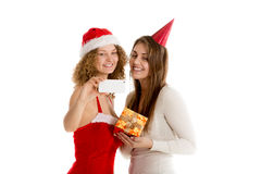 Two girls taking selfie in cristmas costumes horizontal Royalty Free Stock Images