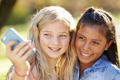 Two Girls Taking Selfie With Mobile Phone Royalty Free Stock Image