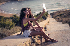 Two girls taking a selfie on vacation Royalty Free Stock Photos