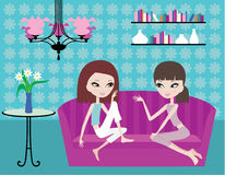 Two girls talk on a sofa Stock Photography