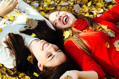 Two girls talking and laughing Stock Images