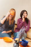 Two Girls Talking on the Phone Royalty Free Stock Photography