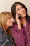 Two Girls Talking on the Phone Royalty Free Stock Photos
