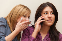 Two Girls Talking on the Phone Stock Photos
