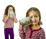 Two girls talking on a tin phone Royalty Free Stock Images