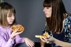 Two girls tasting food Royalty Free Stock Photos