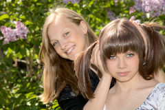 Two girls of the teenager against a  lilac Stock Photos