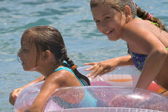 Two girls of teenager bath in a sea (7) Stock Image