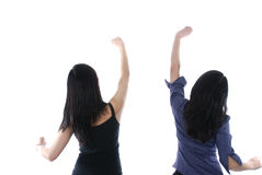 Two girls with their hands up Stock Image