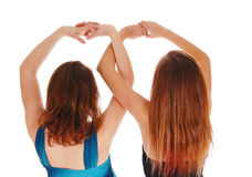 Two girls with there hands up. Royalty Free Stock Photo