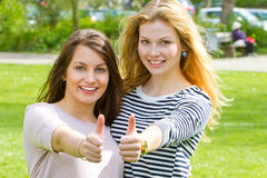 Two girls with thumbs up Royalty Free Stock Photography