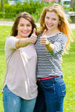 Two girls with thumbs up Stock Images