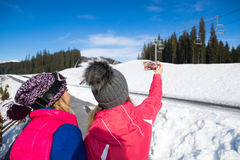 Two Girls Tourist Snowboard And Ski Resort Snow Winter Mountain  Woman Taking Selfie Photo. Two Girls Tourist Snowboard And Ski Resort Snow Winter Mountain Two Royalty Free Stock Images