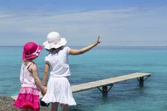 Two girls tourist turquoise sea Royalty Free Stock Images