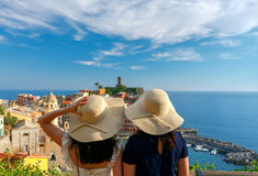 Two girls tourists admiring Vernazza. Stock Image
