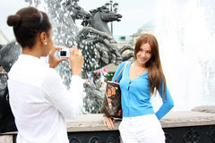 Two girls tourists are photographed Stock Photography