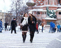 Two girls tourists are photographed in Moscow (Russia) Stock Images
