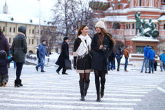 Two girls tourists are photographed in Moscow (Russia) Stock Image
