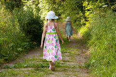 Two girls are on the trail in the forest Royalty Free Stock Photography