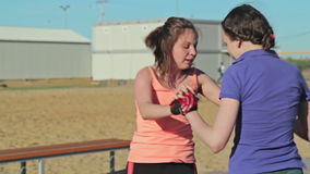 Two girls train - jumping exercise. Outdoor crossfit stock video footage