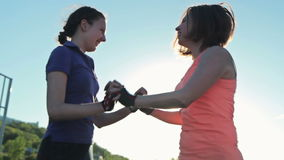 Two girls train - jumping exercise. Outdoor crossfit stock footage