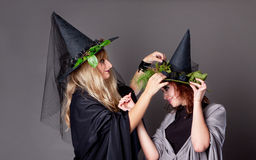 Two girls treated costumes of witches Royalty Free Stock Image