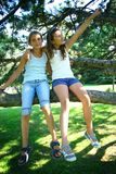 Two girls in tree Stock Photo