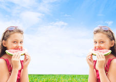Two girls twins eating watermelon Royalty Free Stock Image
