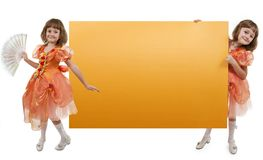 Two girls twins hold banner Stock Photography