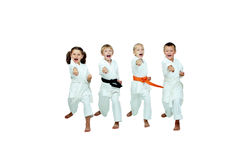 Two girls and two boys hit a punch arms on a white background Stock Image