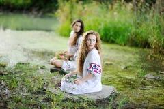 Two girls in Ukrainian shirts Stock Photos