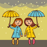 Two girls under umbrellas Stock Photo