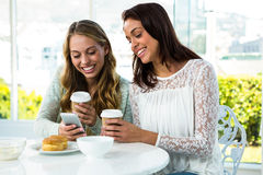 two girls use a phone Stock Photo