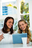 Two girls use a tablet Royalty Free Stock Photos