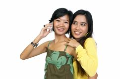 Two girls using cellphone Royalty Free Stock Photography