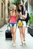Two girls using  GPS navigator for find a way Royalty Free Stock Photo