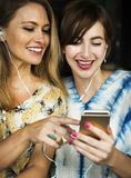 Two Girls Using Iphone Stock Images
