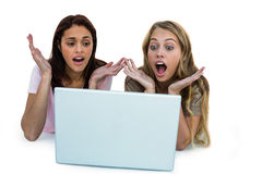 Two girls using a laptop Stock Photos