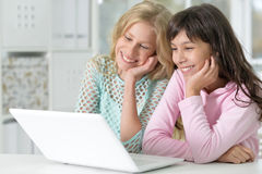 Two girls using laptop Stock Photography