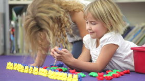 Two Girls Using Plastic Model Toys In Maths Class stock video footage