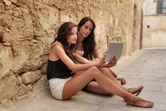 Two girls using a tablet Stock Photo