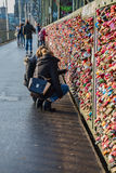 Two Girls Viewing  the Love Locks in Cologne Koln Germany. Two girls looking at the Love Locks on the Hohenzollern Bridge over the Rhine River in Cologne Royalty Free Stock Images
