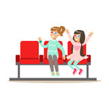 Two Girls Waiting Taking Seats In Cinema Room, Part Of Happy People In Movie Theatre Series Royalty Free Stock Photos