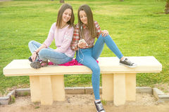 Two girls on walk in park Royalty Free Stock Photos