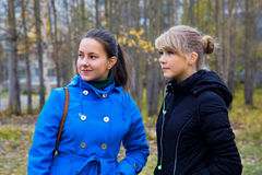 Two girls walking in the autumn park Royalty Free Stock Photography